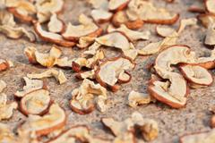 Sun drying sliced apples with selected focus Stock Photos