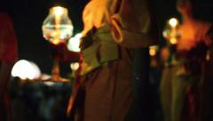 Defocused video of Buddhist monks walking, holding candles during the Yii Peng Stock Footage