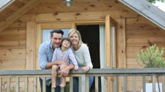 Family enjoying vacation in log cabin Stock Footage
