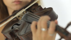 Close up of beautiful girl playing the violin masterfully Stock Footage