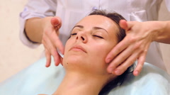 Facial massage beautiful girl.Portrait of a girl in a massage parlor. - stock footage