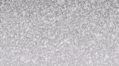 Christmas heavy snow loop on light grey background. - stock footage