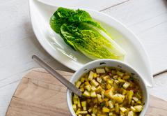 romaine lettuce hearts with mango apple vinaigrette - stock photo