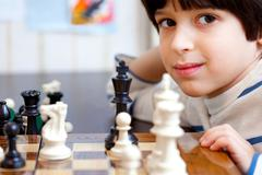 boy and chess, close-up - stock photo