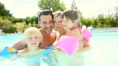 Happy family enjoying swimming-pool time Stock Footage
