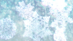 Big Christmas snowflakes loop with sparkly defocused background. White version. - stock footage
