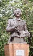 monument uyghur composer and teacher quddus kuzhamyarovu. almaty, kazakhstan - stock photo