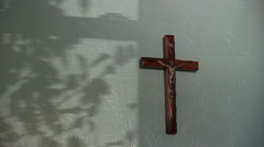 Cross hanging on a wall Stock Footage
