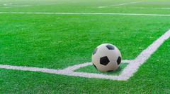 white stripe on the green soccer field from top view - stock photo