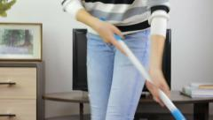 Woman cleaning home easily Stock Footage