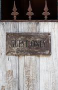 wood door with guest only sign - stock photo