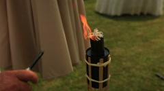 Flame from a torch at early evening in nature Stock Footage