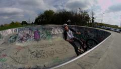 Slow Motion Steadicam BMX Tailwhip in Graffiti Covered bowl Stock Footage