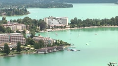 Beautiful turquoise sweet water lake with hotels at the shore, Austria, Stock Footage