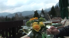 Clinking glasses of wine in the european alps. Stock Footage