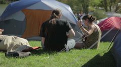 Campers Playing Music at music Festival Tent Site Stock Footage