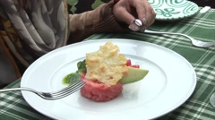 Woman is eating a piece of her salmon tartare Stock Footage