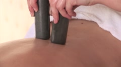 Massage with two stone sticks. Stock Footage