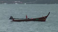 Small asian fisher boat swimming in the sea Stock Footage