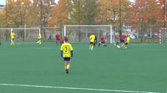 Unknowns athletes in red and yellow uniform are playing football Stock Footage