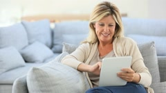 mature woman websurfing on internet with tablet - stock footage