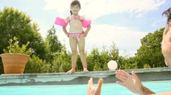Little girl with daddy in swimming pool Stock Footage
