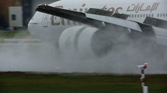 Emirates Boeing 777 landing close view of reverse engine Stock Footage