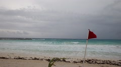 Lifeguard red flag on caribbean beach in bad weather Stock Footage