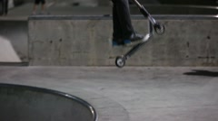 Teens riding their razors at skate park night Stock Footage