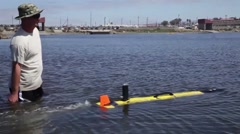 Navy's Autonomous Underwater Vehicle explores coastal waters - stock footage