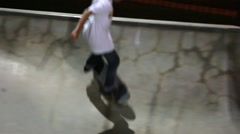 Teens practices tricks at skate park at night Stock Footage