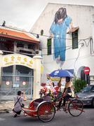 Tourists Taking Photo in Front of Street Art Mural, Georgetown, Penang, Malaysia Stock Photos