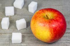 Apple and lump sugar Stock Photos