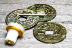 Acupuncture needle on chinese antique coins Stock Photos