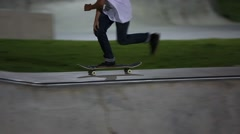 Teen skateboarders at skate park at night Stock Footage