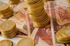 A lot of mexican pesos money, coins and bank notes Stock Photos
