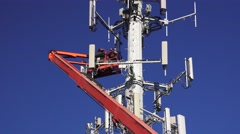 Cell tower, telecommunications ,man Stock Footage