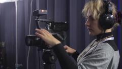 girl-cameraman at work. Media, journalism, press - stock footage