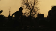 WS PAN Silhouette of man playing basketball / Salt Lake City, Utah, USA. Stock Footage