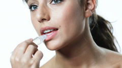 young woman applying lip gloss - stock footage