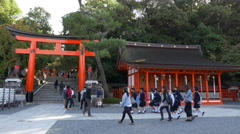 Visitors at Fushimi Inari Taisha in Kyoto, Japan Stock Footage