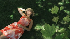 Woman lying on the grass Stock Footage