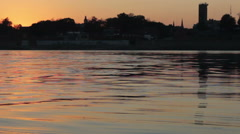 Tower Reflects On Mississippi River At Sunset Stock Footage