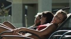 Three girls sunbathing Stock Footage