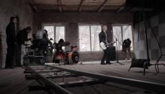 Rock band starring in the music video playing the guitar. Film production - stock footage