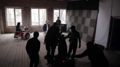 Behind the scenes filming a music video featuring rock group. Film production Stock Footage
