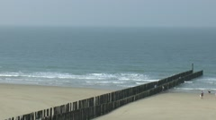 Jetty or breakwater on the beach of the Zeeland place of Domburg Stock Footage