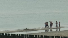 Young people bathing near the Jetty or breakwater Stock Footage