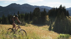 mountain bikers on a trail - stock footage