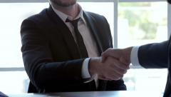 Three businessmen handshake - stock footage